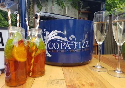 Pimms in Milk bottles and Glasses of Fizz