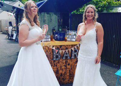 2 brides at the bar